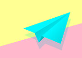 istock blue paper plane icon with shadow on pink and yellow pastel colo 1281286021