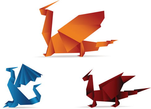 Blue red and orange origami dragons on a white background