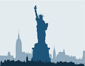 Blue silhouette of Statue of Liberty and New York skyline