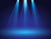 istock blue stage spotlights 1312403920
