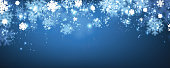Blue shining winter banner with snowflakes. Vector illustration.