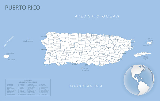 Blue-gray detailed map of Puerto Rico administrative divisions and location on the globe.