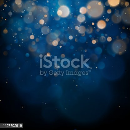 Blurred bokeh light on dark blue background. Christmas and New Year holidays template. Abstract glitter defocused blinking stars and sparks. EPS 10 vector file