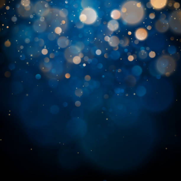 blurred bokeh light on dark blue background. christmas and new year holidays template. abstract glitter defocused blinking stars and sparks. eps 10 - blue stock illustrations