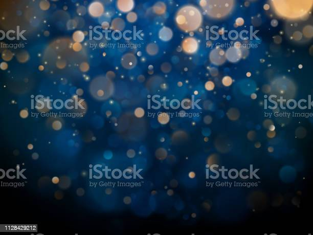Blurred Bokeh Light On Dark Blue Background Christmas And New Year Holidays Template Abstract Glitter Defocused Blinking Stars And Sparks Eps 10 — стоковая векторная графика и другие изображения на тему Абстрактный