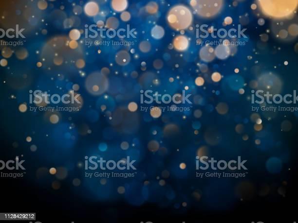 Vetores de Bokeh Turva Luz Sobre Fundo Azul Escuro Modelo De Férias De Natal E Ano Novo Brilho Abstrato Defocused Piscando Estrelas E Faíscas Eps 10 e mais imagens de Abstrato