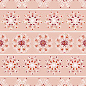 Bohemian Christmas lace snowflakes with horizontal stripes vector seamless pattern on bright orange background for fabric, wallpaper, scrapbooking projects for the winter Holidays. Surface pattern design.