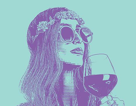 Boho hippie woman drinking glass of wine.