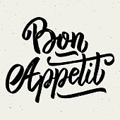 Bon appetit. Hand drawn lettering phrase isolated on white background.