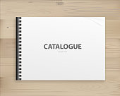 istock Book binder with empty cover for background on wood. 1341046654
