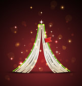 Creative Christmas tree formed from open upside down book.