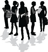 A vector silhouette illustration of young female students standing in a triangle formation.  The young woman hold backbacks, documents, and notebooks.