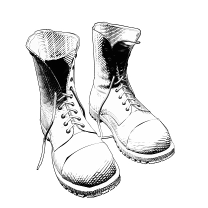 Monochrome vintage engraving drawing a pair of boots illustration isolated on white background