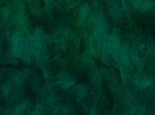 Border of hues of emerald green paint splashing droplets. Watercolor strokes design element. Emerald green colored hand painted abstract texture.