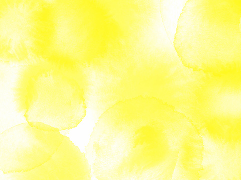 Border of hues of yellow paint splashing droplets. Watercolor strokes design element. Yellow colored hand painted abstract texture.