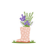 istock A bouquet of flowers in boots. A symbol of spring and gardening. Cute vector illustration. 1301039055