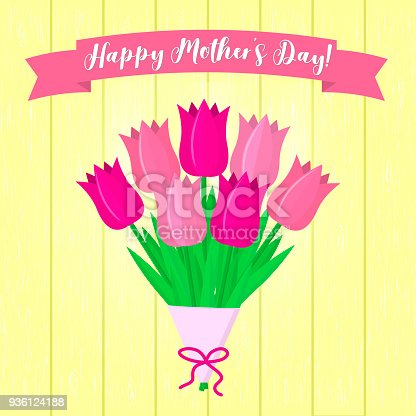 istock A bouquet of pink tulips, a sticker with text and a ribbon on the background of a yellow wood texture. Congratulations. Mothers Day 936124188