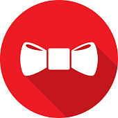 Vector illustration of a red bow tie icon in flat style.