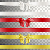 Bows Made of Satin Ribbon in White, Red and Gold Color