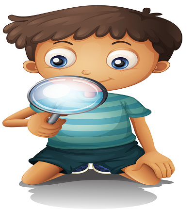 Boy and a magnifier