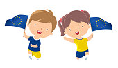 Boy and girl holding Europe flag