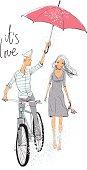Boy and girl in love under rain