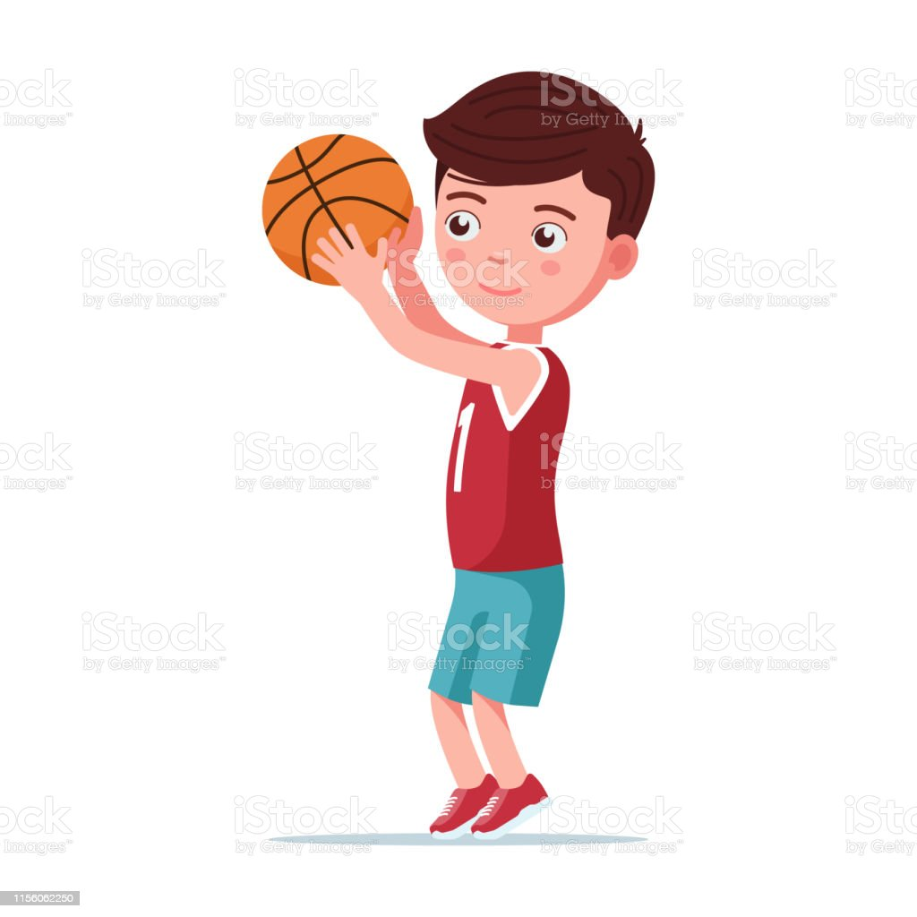 Boy basketball player throws the ball in the basket. Little boy plays...