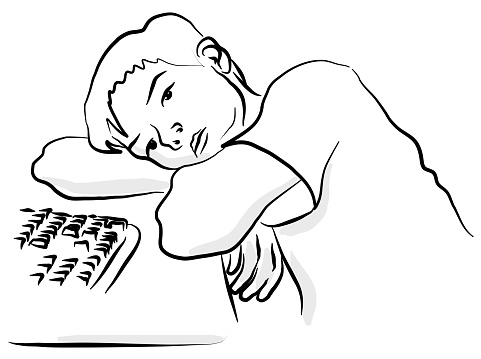 Boy Dreaming At His Desk