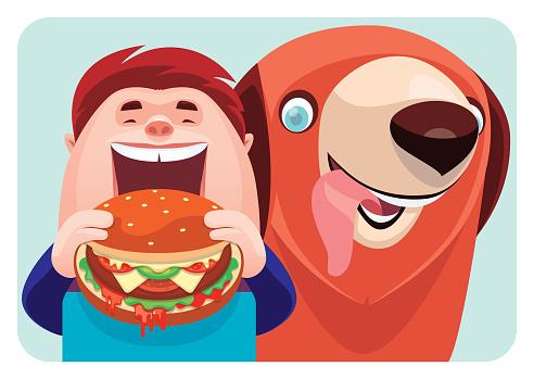 boy eating hamburger with dog