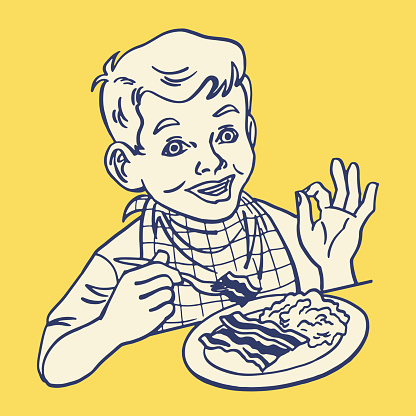 Boy Eating Scrambled Eggs and Bacon