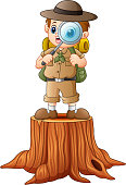 Vector illustration of Boy explorer with magnifying glass on tree stump