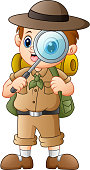 Vector illustration of Boy explorer with magnifying glass
