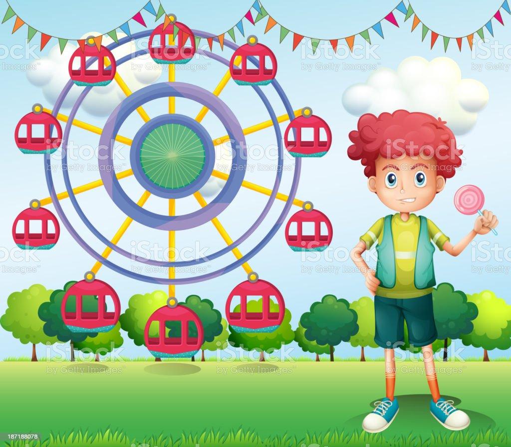 boy holding lollipop beside ferris wheel royalty-free stock vector art