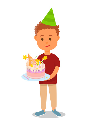 Boy in Birthday Hat Holding Cake with Sweets.