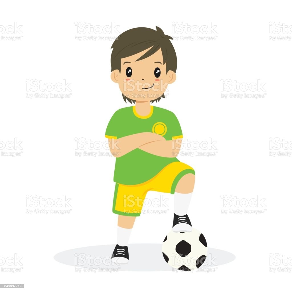 royalty free boy in his yellow uniform playing soccer at the field rh istockphoto com