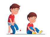 Boy kid dressing up or changing pants. Child put up clothes by himself. Guy lacing his shoes. Children undressing and dressing confidently. Flat vector illustration