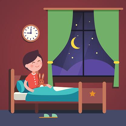 Boy Kid Preparing To Sleep Bedtime In His Bed Stock