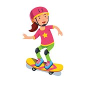 Boy kid wearing helmet skating on skateboard