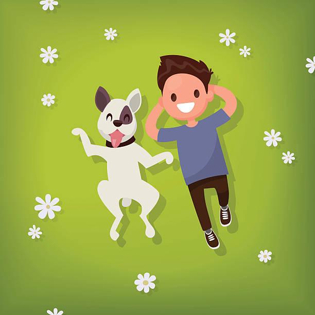 ilustrações de stock, clip art, desenhos animados e ícones de boy lies with the dog on the lawn. vector illustration - training