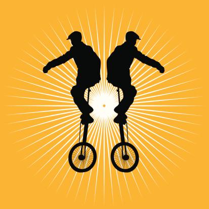 Boy on unicycle