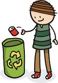 A boy throwing a drinks can into a recycling bin.