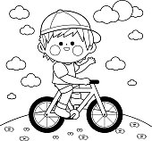 Boy riding a bicycle at the park. Black and white coloring book page