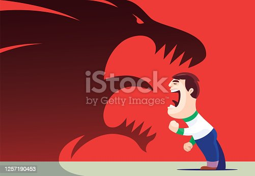 istock boy screaming and facing to roaring lion shadow 1257190453
