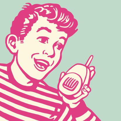 Boy Talking into a Walkie Talkie