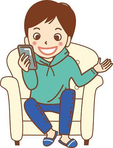 A boy talking on a smartphone.