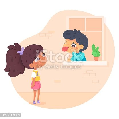 istock Boy teases girl, showing his tongue and grimacing insultingly 1272668099