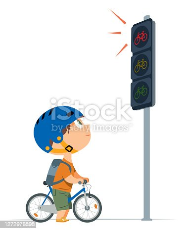 istock Boy waiting for green traffic light with his bike 1272976898