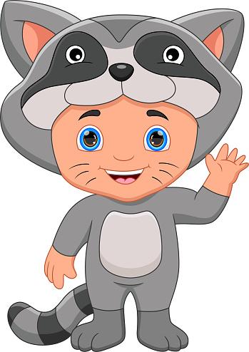 boy wearing raccoon costume waving