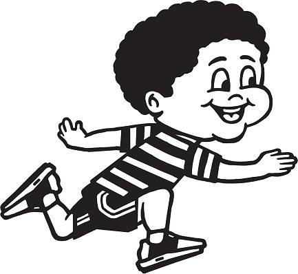Boy wearing shorts and striped t-shirt smiling while running