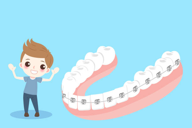 boy with tooth brace - orthodontist stock illustrations, clip art, cartoons, & icons